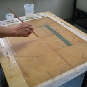 Tear repair with Japanese tissue paper and starch paste.