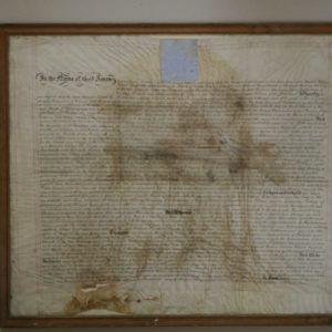 Poorly framed and water damaged parchment deed