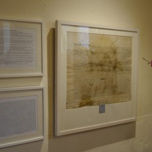 The parchment thread mounted in a new frame