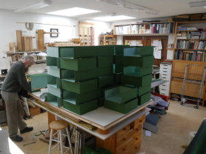 Stacks of box trays for assembly