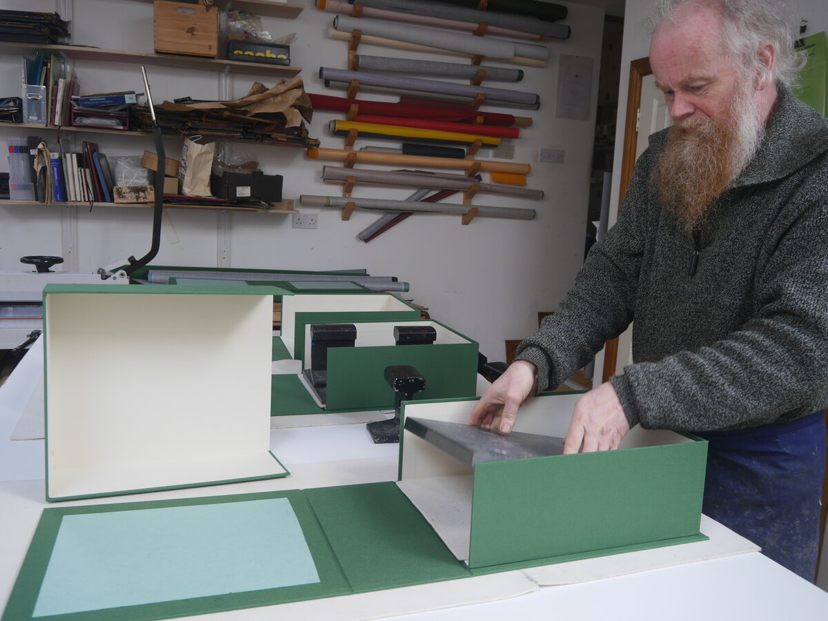 Covering box trays in green cloth